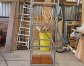 Storage Shelving unit fabricated in square steel and fine red cedar peruvian wood