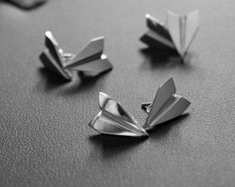 Paper plane studs