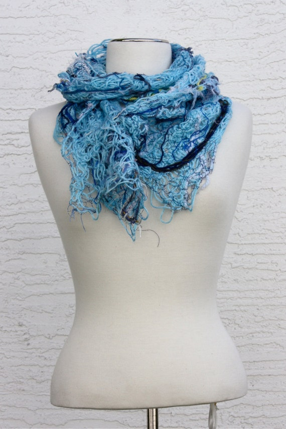 Sky, an Eleganza Scarf in blue made from thrums