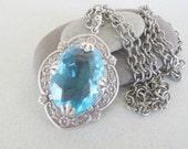 Aquamarine Faceted Glass Pendant
