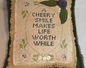 Primitive cross stitch sampler pillow purple green