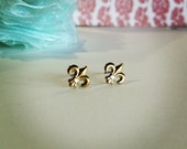 tiny fleur de lis earrings. studs. perfect gift for woman or girl. modern and minimal. new orleans louisanna inspired.