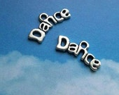 10 'dance' charms, silver tone, 21mm