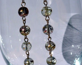 Gold beaded earrings with gold accents