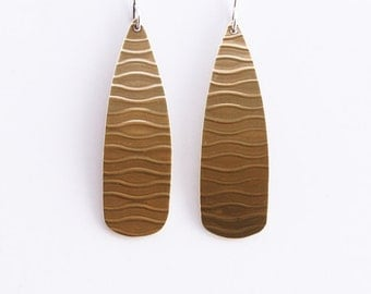 "Brass earrings with a unique wavy pattern embossed on long teardrop shape dangling from sterling silver earwires - ""Soledad Earrings Brass"""