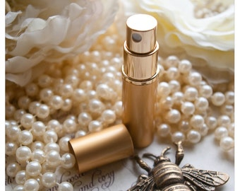 the kallisti's charm - natural perfume or cologne oil spray held captive within golden bottle - pick your poison - oodles of aroma options