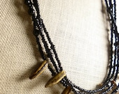 necklace - onyx and seed pods