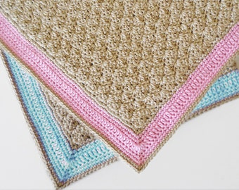 Crochet baby blanket in beige and pink for baby girl