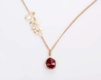 Necklace: Gold plated frame, faceted  ruby glass pendant tripple gold plated leaves