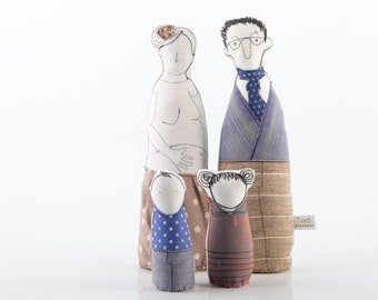 Young growing family - two parents ,son and , daughter. Pregnant woman, dressed in natural tones and blue, handmade fabric dolls