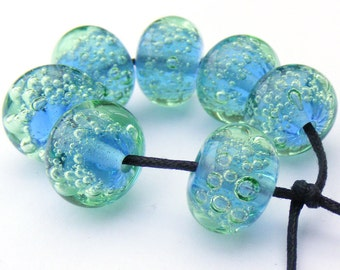 Handmade lampwork bead set of 7 blue and pale green glass bubble beads