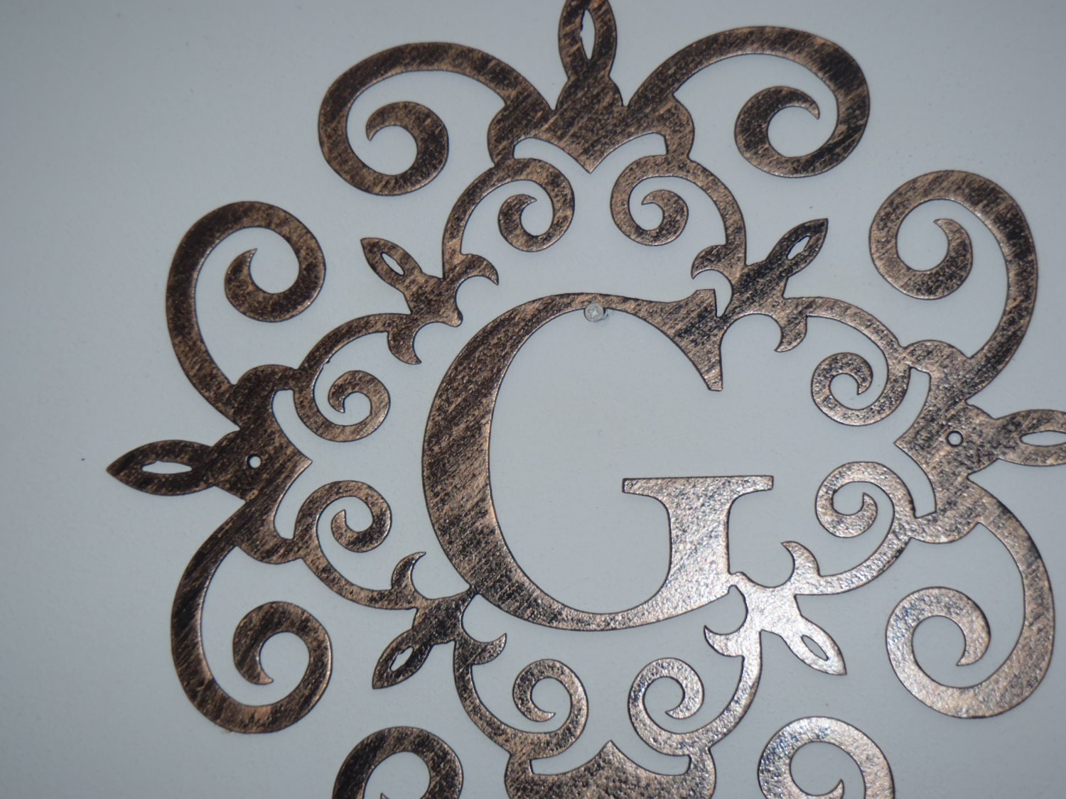 family initial monogram inside a metal scroll with wall. Black Bedroom Furniture Sets. Home Design Ideas