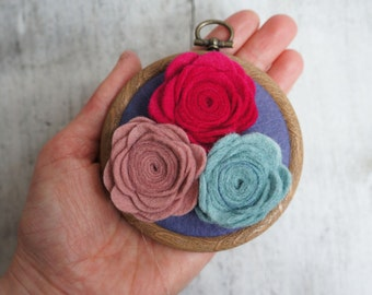 handmade felt wall hanging with felt roses.