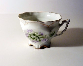 Hand Painted German Tea Cup with Green Leaves, White and Lavendar Flowers and Gold Rim - Welmar Germany