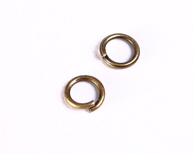 5mm Petite antique brass jumprings - antique brass jump ring - open jumpring - round jumpring (992) - Flat rate shipping