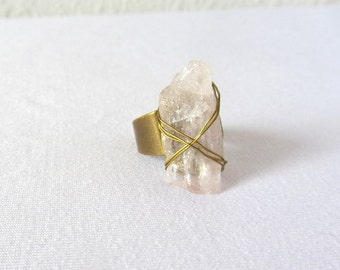Quartz mineral ring. Gold brass adjustable ring wire wrapped with a pink quartz raw rock stone.