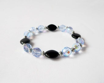 Sky blue and black bracelet handmade with sky blue crystal and black glass beads. ooak made in Italy