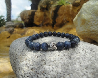 Dumortierite/Navy Blue 8mm Stretch Bracelet with a Sterling Silver Accent Bead..