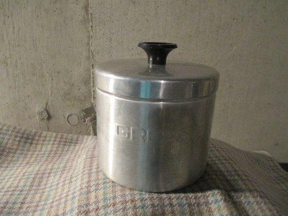 Vintage aluminum grease can with strainer