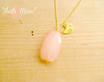 Peach coral drop necklace with little bird charm on gold chain
