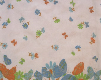 1960's butterfly border print cotton flannel fabric, turquoise, robin's egg blue, orange, lime green, & gold on white, 2 1/3 yds available