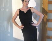 Black stretch low-back dress in bamboo-spandex jersey with cowl neck.