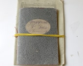 The Little Lost Notebook, handmade notebook, slate gray and red, saddle stitched