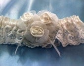Wedding garter.. white lace with white ribbon and 3 satin and sheer rose