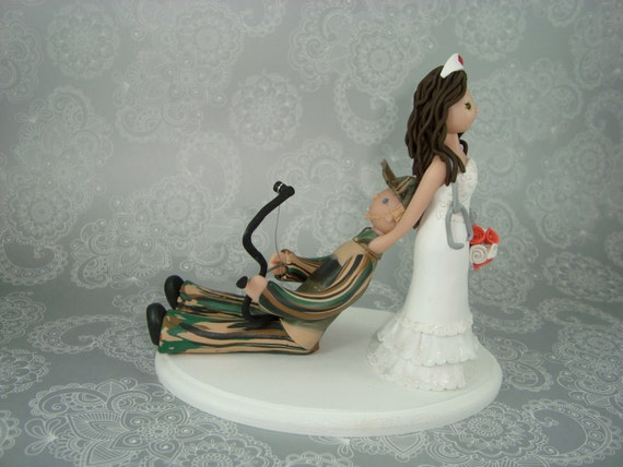 nurse wedding cake toppers dragging personalized wedding cake topper 17951