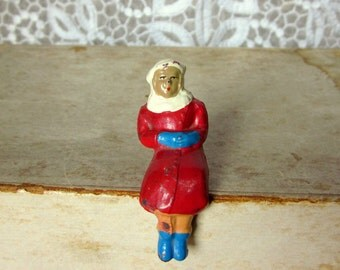 "Vintage Cast Iron Doll, Sitting Metal Doll with Red Coat, Blue Gloves, 2 1/8"" Tall"