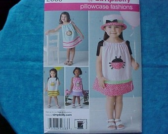 Simplicity Pattern 2383 Size 1/2-4 Pillow case dress and hat.