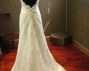 Wedding Dress with Plunging Back and Hand Beaded French Lace