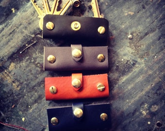 Leather and brass key holder