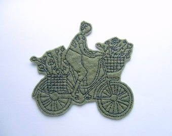 Female biker iron on patch applique in moss green felt and charcoal embroidery thread