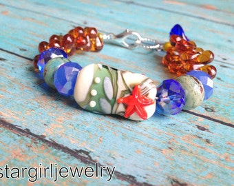 Seaside glass focal lampwork glass beaded weave bracelet...lampwork glass beads by Marianna