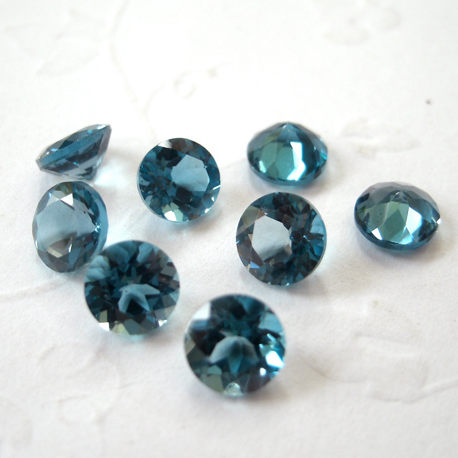 faceted gemstones blue topaz brilliant cut aaa 4mm for