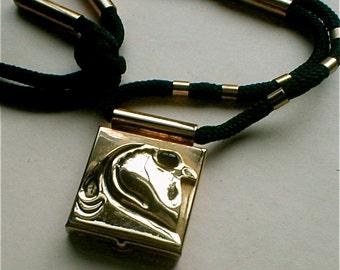 Golden Hawk Locket   Vintage 80s Necklace  Modern Bird of Prey  Contemporary Cord Necklace  Egyptian God Horus