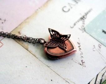 butterfly. heart locket necklace. copper ox