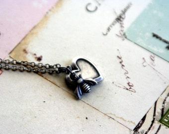 bee. heart locket necklace. silver ox