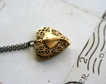 sting ray. locket necklace. gold ox