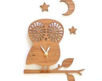modern clock, owl clock set with branch, moon and stars