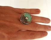 Statement ring.Turquoise ring.  Turquoise gemstone  set in a beautiful sterling silver hammered ring. Turquoise donut ring .