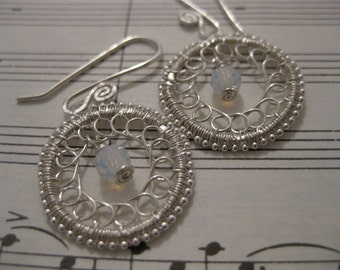 Wire wrapped sterling silver earrings, opal-colored crystals