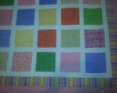 Brightly colored twin size quilt