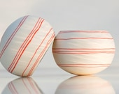Porcelain candle holder with colorful orange stripes- Tea Light Delight design N.9 (orange). Crafted by Wapa Studio.