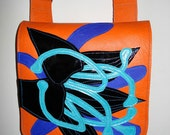 Handmade Square Bag in bright orange leather with black patent appliqued Lily