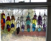 another flock  Indian Chief  Eagle Feather  stained glass with Beads in purples blues etc