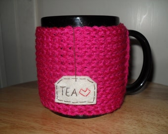 Knitted mug cozy cup cozy in fuschia hot pink vibrant pink with hanging tea tag with red heart
