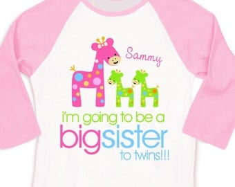 Big sister to be to twins funky giraffe pregnancy announcement pink/white raglan shirt