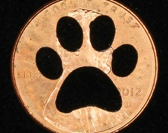 Lucky penny with paw print cut out